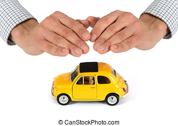 Hands Providing Protection Over Yellow Toy Car - Adult Male...