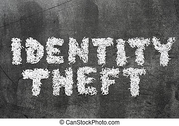 identity theft phrase made from shredded paper on blackboard...