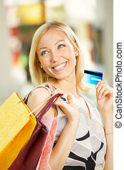 Do shopping! - The beautiful girl with purchases and a...