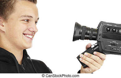 young photographer - A young photographer with a 8mm camera