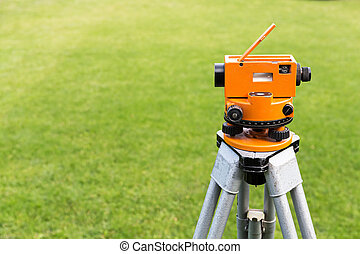 Optical level on tripod - Construction surveyor equipment...