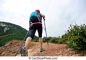 young woman hiking on mountain - young woman hiking on...