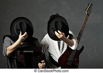 Musicians - Two musicians with a guitar and an accordion...