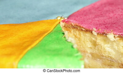 Multi-colored cake - Rotation colored cake in form of a...