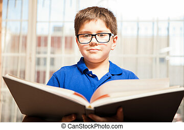 Young kid reading a book