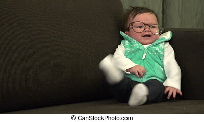 Wacky Baby Wearing Adult Glasses - A silly baby wearing a...