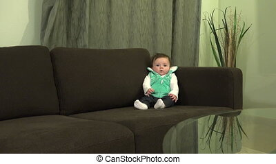 Baby Lifestyle Glass Table - A long shot of a baby with a...
