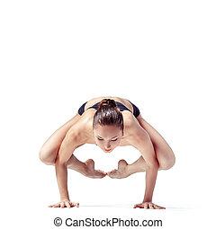 the yoga woman - young beautiful yoga posing on a gray...