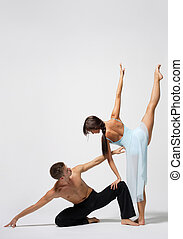 beautiful couple - two modern ballet dancers posing on white