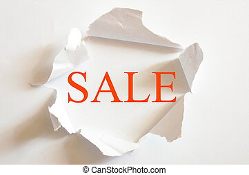 sale concept with hole in blank paper