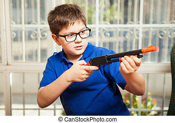 Kid shooting a toy gun
