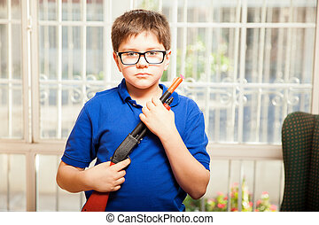 Nerdy kid with a toy gun