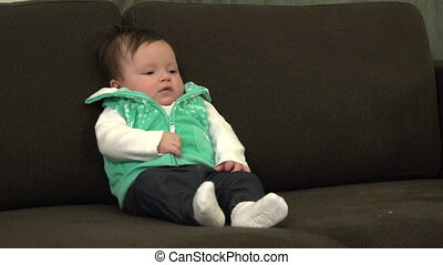 Baby Sitting Up on Couch Crying Out - A sweet newborn baby...