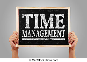 Time management - Hands are holding the blackboard of Time...