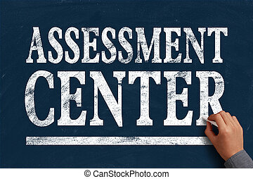 Assessment center - Businessman is writing Assessment center...