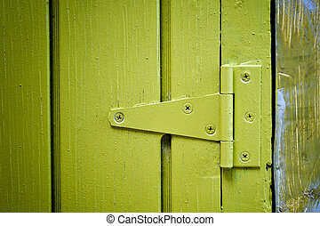 Yellow door hinge