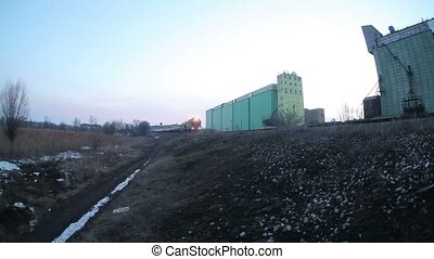 freight train carries oil drums cars, winter evening -...