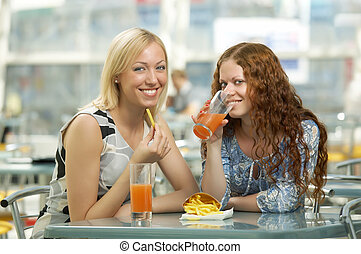 Fast food - Two girls eat in fast food cafe