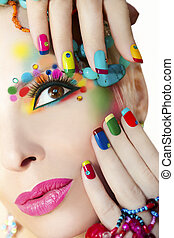 Colorful French manicure and makeup on the girl with...