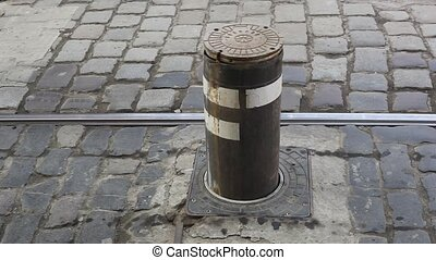 underground barrier. Pillar regulates passage of trams on...