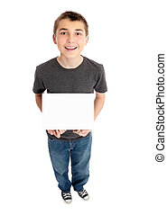 Boy holds a sign - A pre teen boy holding a small blacnk...