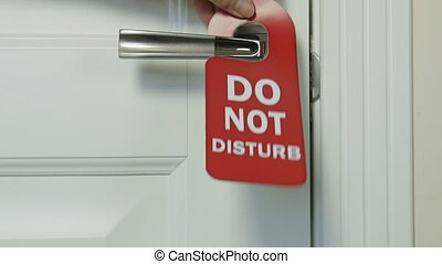 Do not disturb sign on hotel room door