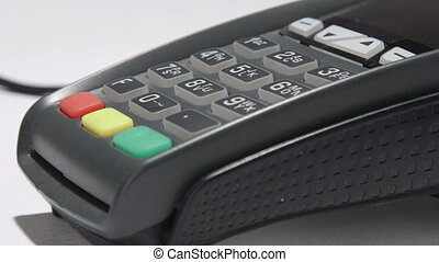 Person using credit card processing terminal closeup