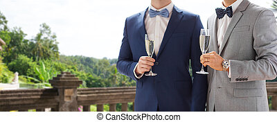 close up of male gay couple with champagne glasses - people,...