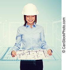 businesswoman in helmet looking at blueprint