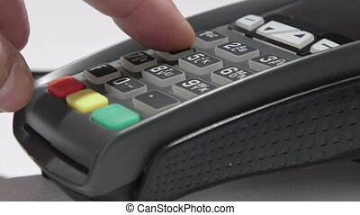 Hand dials the pin code into credit card reader
