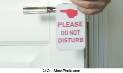 Do Not Disturb hanger on the door of hotel room - Female...