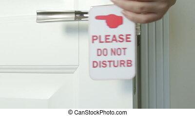 Do Not Disturb hanger on the door of hotel room - Female...