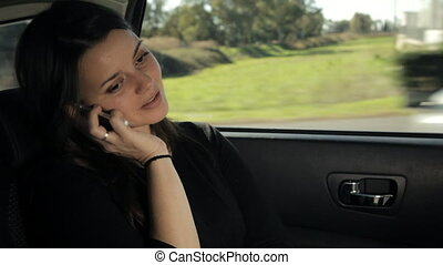 woman sitting back in the car