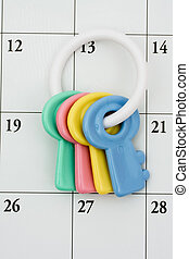 Baby Rattle - Colourful baby rattle on a calendar...