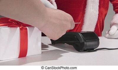 Santa Claus using credit card processing terminal