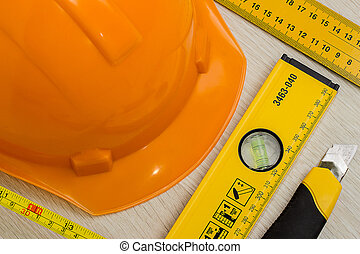 Construction helmet and tools as background