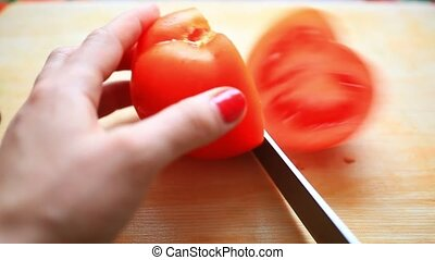 Chef Hand and Knife Slicing Tomato. Close up. HD. 1920x1080