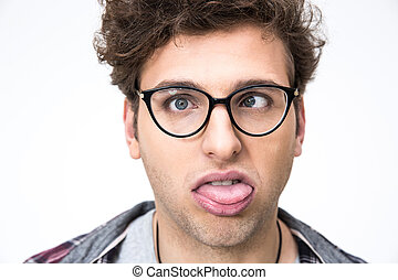 Closeup portrait of a funny young man over gray background