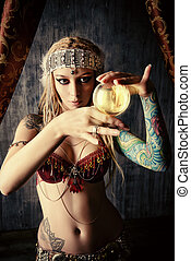divination - Magnificent fortune teller holding crystal...