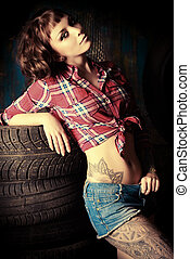 mechanic woman - Stunningly sexual young woman posing in the...