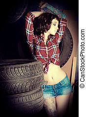 hot mechanic - Stunningly sexual young woman posing in the...
