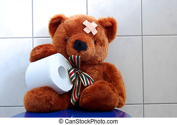 toy teddy bear on wc toilet - toy teddy bear with paper in...