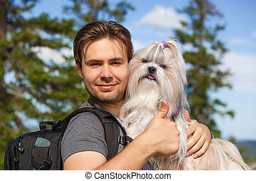 Young man tourist with dog - Young smiling man tourist with...