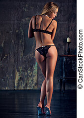 Young sexy woman - Young slim sexy woman in black lingerie...