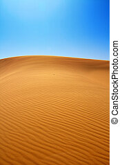 sand dunes and cloudless sky