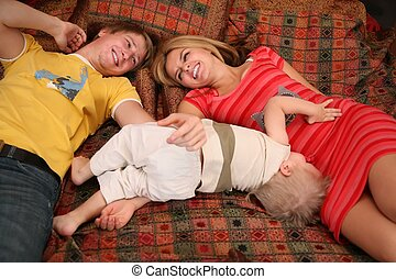 parents with child on carpet