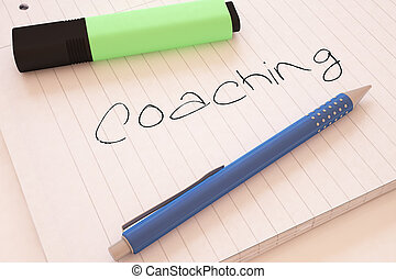 Coaching - handwritten text in a notebook on a desk - 3d...