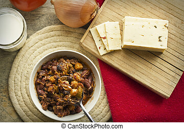 Chili Con Carne - Hot and spicy Chili con carne with a glass...