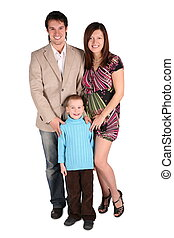 Young family posing, pregnant mother