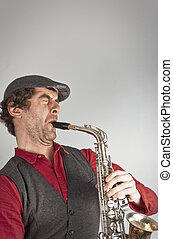 Saxophone Musician - Ugly man wails on saxophone while...